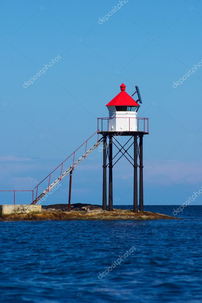 Small signal tower with solar panel situated on a skerry on the southern coast of Norway  — Stock Photo #6169187