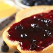 Blueberry Jam on Half a Bun — Stock Photo