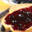 Stock Photo: Blueberry Jam on Half a Bun