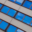 Clouds reflection in Office Building. — Stock Photo