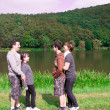 Family at the lake. — Stock Photo