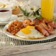 Stock Photo: Breakfast with scrambled eggs and bacon