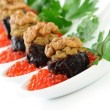 Prunes stuffed with liver pate with nuts in a red caviar — Stock Photo