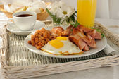 Breakfast with scrambled eggs and bacon — Stock Photo