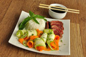 Veal meat with the blood with rice and vegetables — Stock Photo