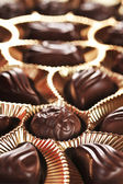 Gold foil box of chocolates — Stock Photo