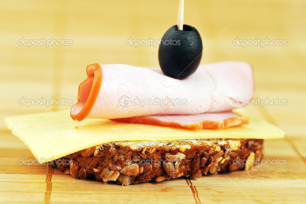 Sandwich with ham and cheese. close up — Stock Photo #5647371