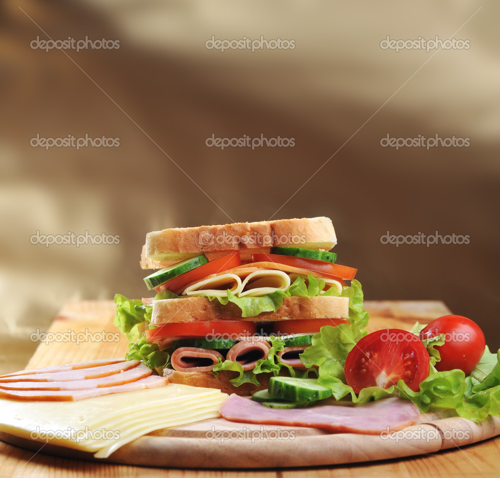 Fresh and tasty sandwich on wooden  table — Stock Photo #5647414