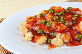 Chicken with red sauce — Stock Photo