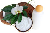 Coconut and massage oil — Stock Photo