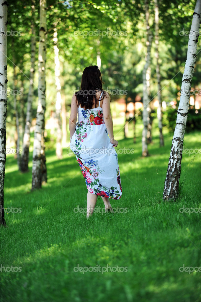 Beautiful  woman walking on  grass in  birch grove .  summer's day. — Stock Photo #6432415