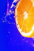 Juicy orange and splashes — Stock Photo