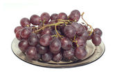 Red wine grape branch on transparent plate isolated on white — Stock Photo
