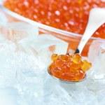 Salmon caviar in ice — Stock Photo