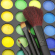Stock Photo: Eye shadows palette and brushes