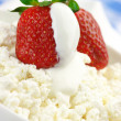 Strawberries on cottage cheese — Stock Photo