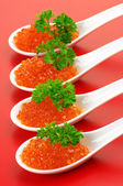 Salmon caviar in spoons — Foto Stock