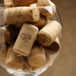 Wine corks in glass - Stockfoto