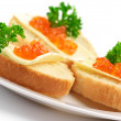 Canapes with salmon caviar - Stock Photo