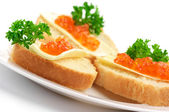Canapes with salmon caviar — Stock Photo