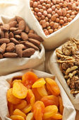 Assorted nuts and dried apricots — Stock Photo