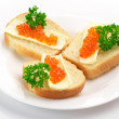 Royalty-Free Stock Photo: Canapes with salmon caviar