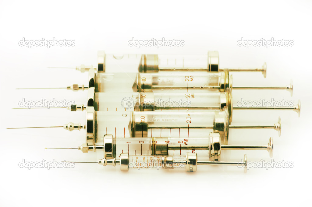 Set of glass syringes isolated on white background. Toned image. — Stock Photo #5685095