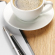 Foto Stock: Clipboard and coffee