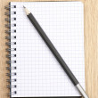 Notepad and pencil — Stock Photo