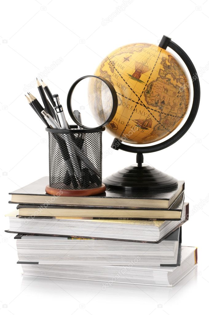 Vintage globe on stack of books and office supplies isolated against white background. — Stock Photo #5953509