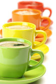Coffee in colorful cups — Stock Photo