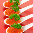 Salmon caviar in spoons — Stock Photo