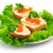 Canape with salmon caviar — Stock Photo #6307124
