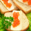 Canape with salmon caviar — Stock Photo
