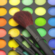 Eye shadows palette and brushes - Stock Photo