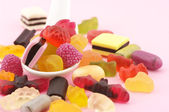 Colorful candy in spoon — Stock Photo
