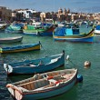 Colorful fishing boats in the fishing village Marsaxlokk, Malta — Stock Photo