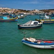 Colorful fishing boats in the fishing village Marsaxlokk, Malta — Stock Photo #5706918