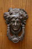 Knocker shaped metal woman — Stockfoto