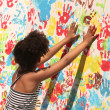 Stock Photo: Girl playing with paint