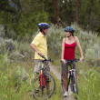Healthy Couple on Bikes in a Forest — Stock Photo