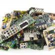 Broken electronics on a garbage dump - Stock Photo