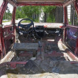 Stock Photo: Old rusty red car inside view