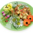 Fried vegetables with flowers — Stock Photo