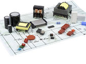 Electronic components and the electric scheme — Stock Photo