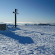 Stock Photo: Cross on peak in mountains at winter