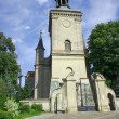 Church tower in countryside - Stock Photo