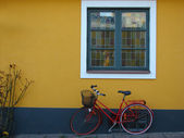 Yellow wall with blue window — Стоковое фото
