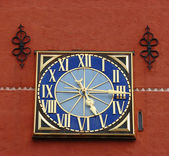 Clock on red wall — Stock Photo