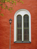 Red wall with window — Stock Photo